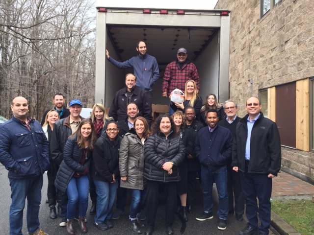 The staff of Carrington Farms donating 75 turkey for the holidays 2016 to Table to Table
